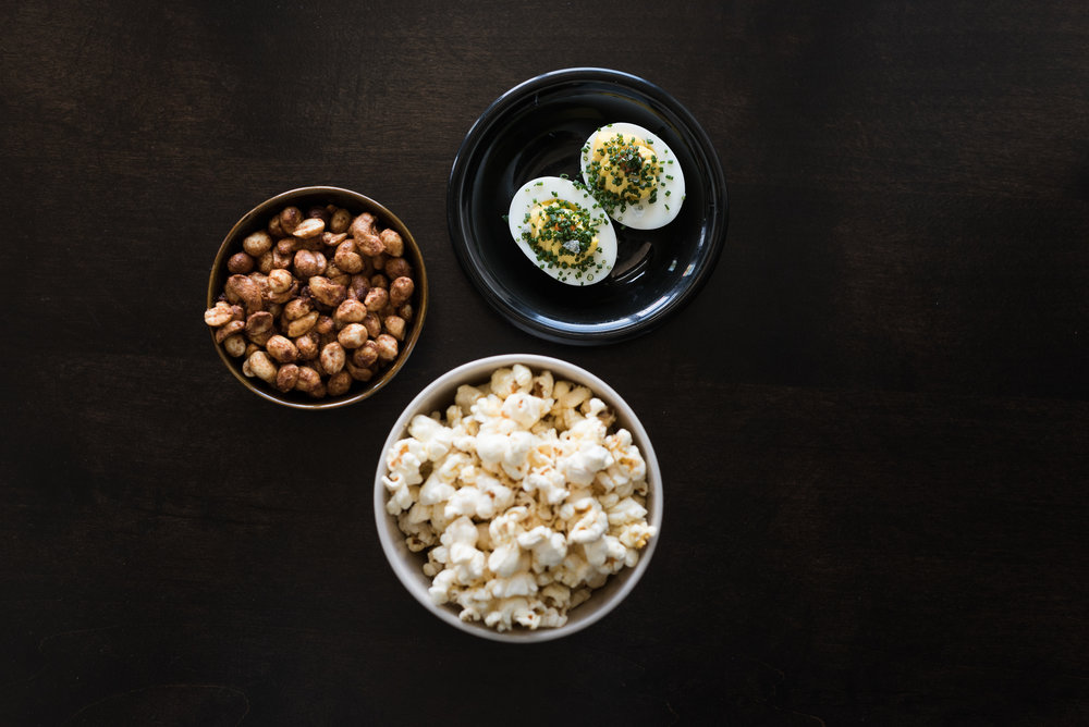 Annette's bar snacks: House-made popcorn, spiced nuts and deviled eggs