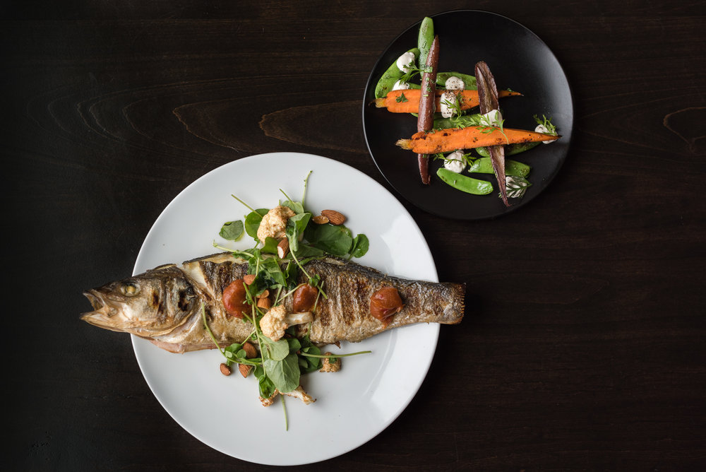 Whole roasted fish with calabrian chili jam, almond, cauliflower and watercress