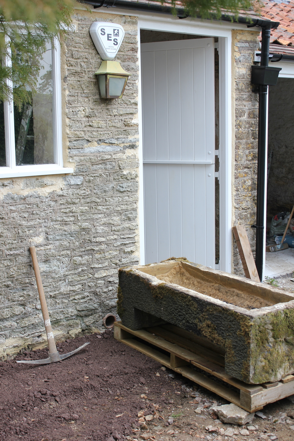 The reclaimed stone trough arrives