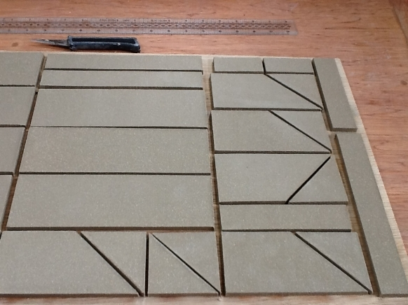 And of course if you are making for a specific scheme the tiles can be pre-made to size and shape, thus avoiding costly and wasteful cutting of fired tiles.... easy!