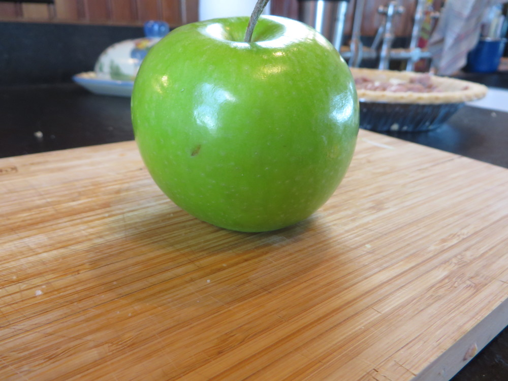 While sausage browns, peel and slice one apple - I prefer Granny Smith, but any tart, firm apple will do.
