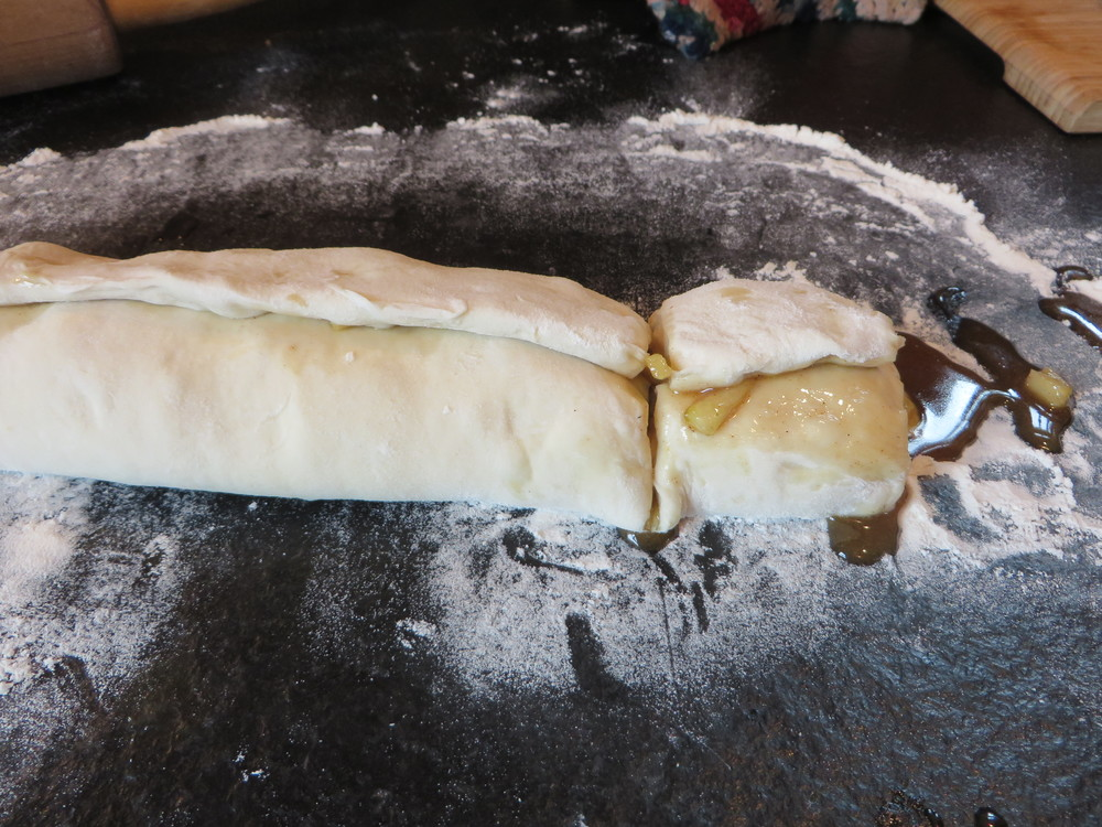 Roll into log shape. (Hint... if you pull the dough a little bit and then kind of fold/lay it over the filling, it won't push out so easily.) Slice into desired size rolls.