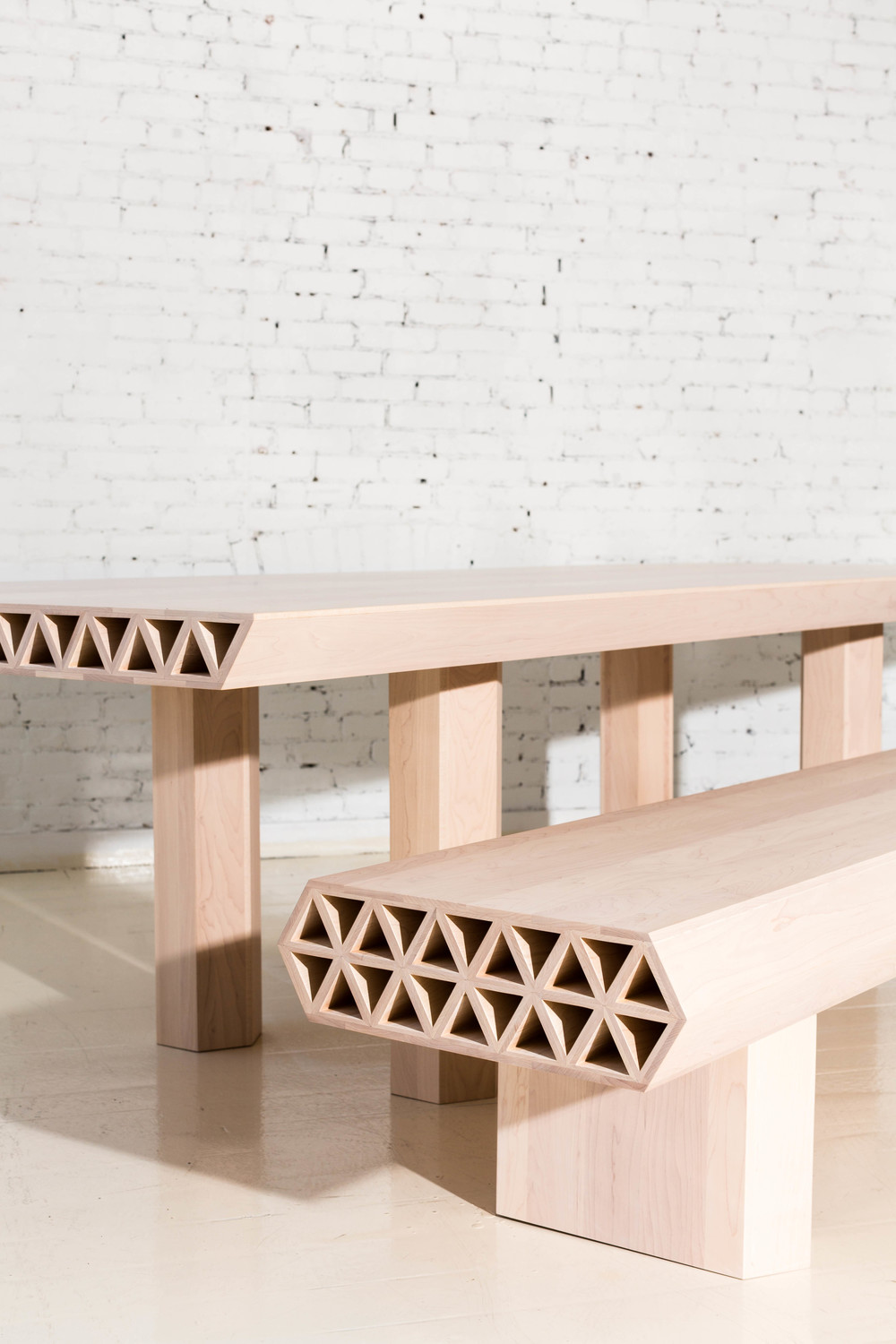 The  Assemblage Wood Dining Table and Bench , from 'Qualities of Material' by Fort Standard