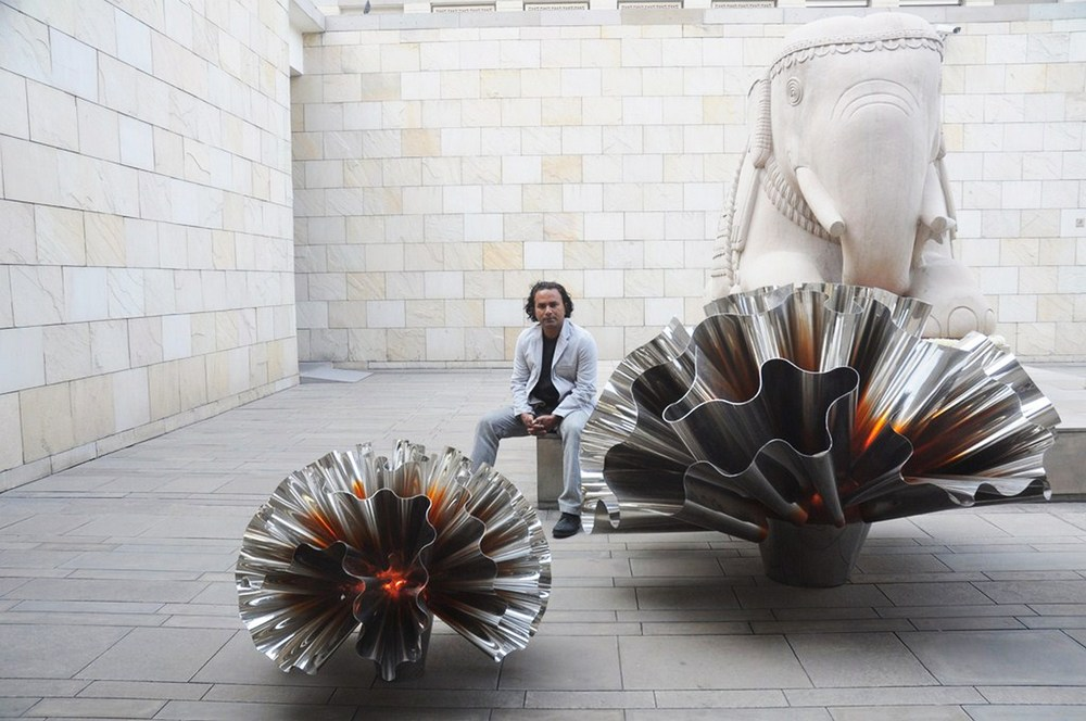 Alex Davis with an installation from  Marigold,  by his studio, which takes inspiration from the Marigold flower.