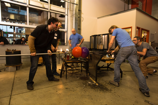 Fusing together individually blown glass spheres: Kiley and his team in the Hot Shop