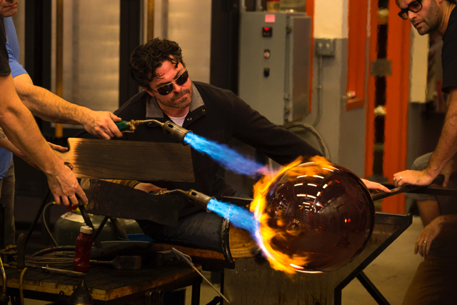 John Kiley, creating perfect orbs and curves, the first segment of his process, with his team in the Hot Shop.