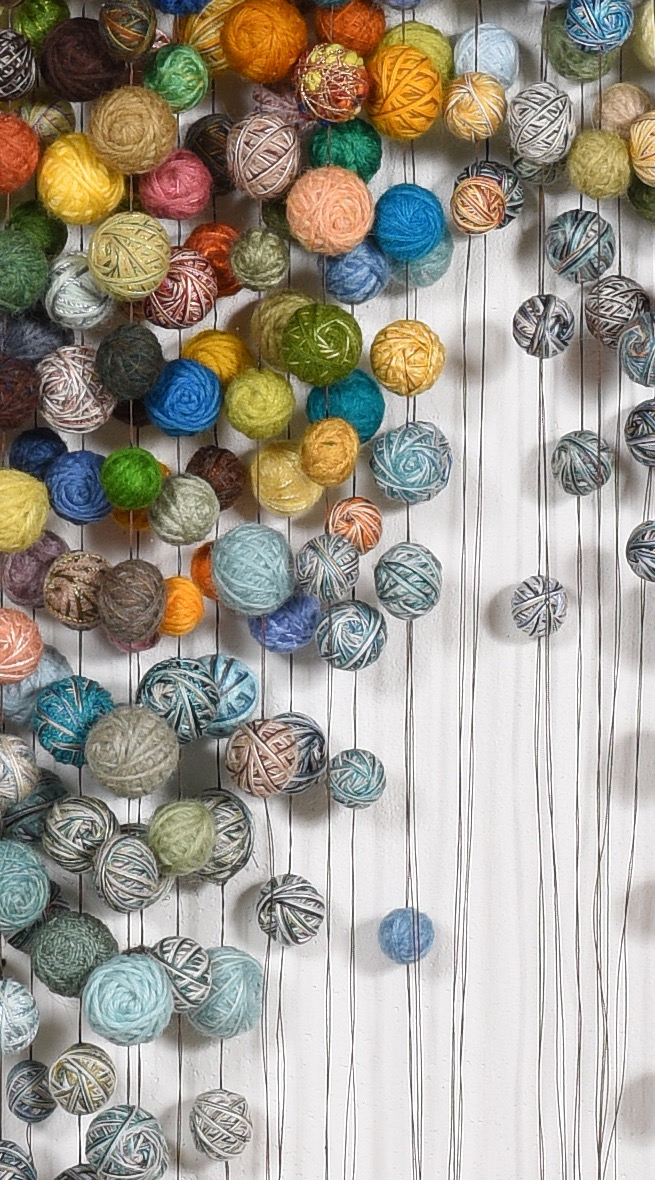 A closeup view of Nelson's Temari–Perfect spheres of discarded yarn and fine thread.