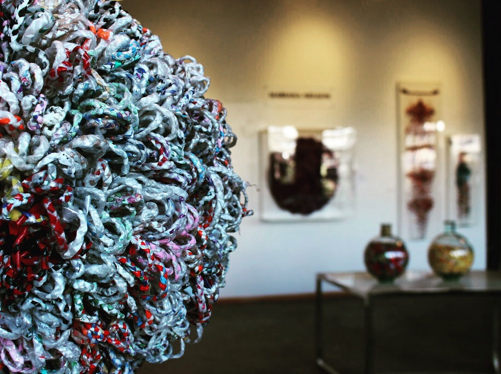 Braiding discarded, recycled material into art, by Mariana Nelson.
