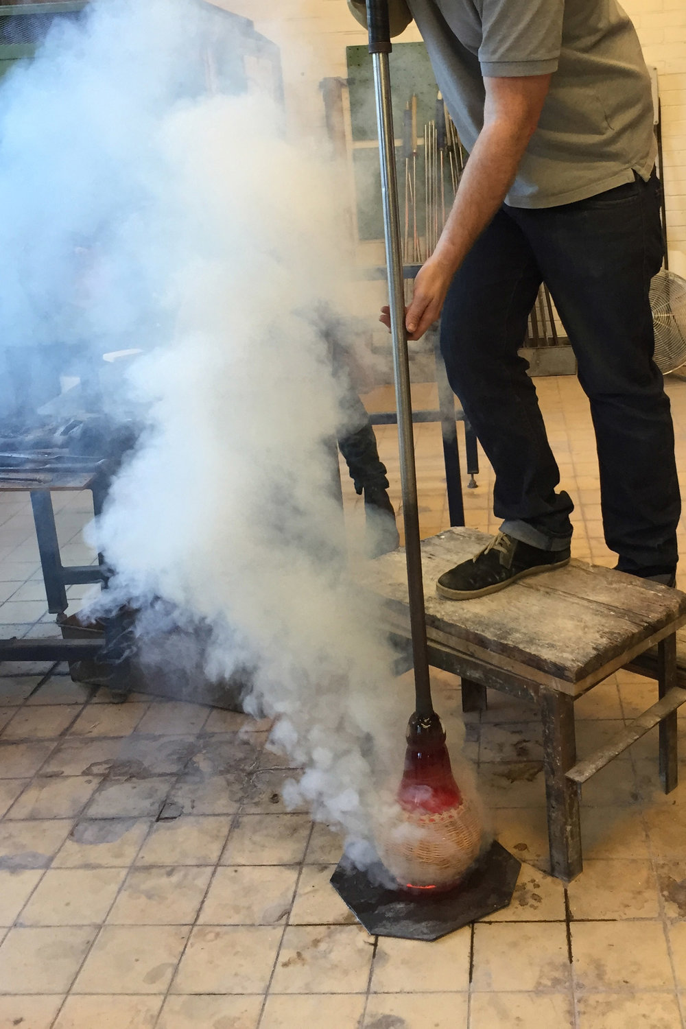 Blowing glass into wicker-basket moulds, for  Wickered