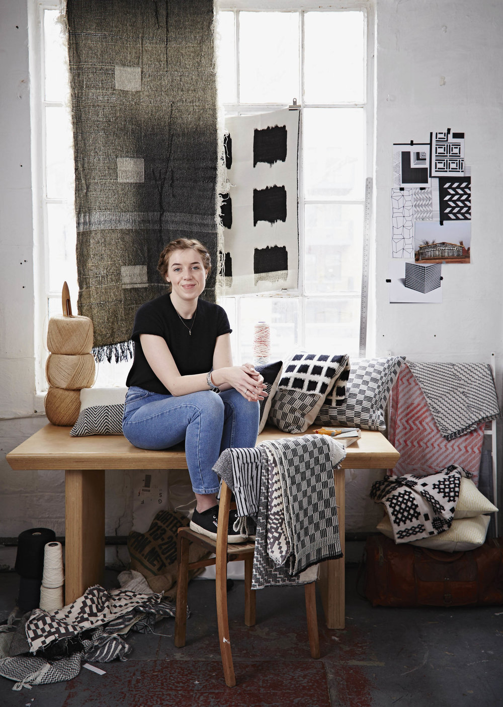 Beatrice in her London Studio, surrounded by woven textiles, including the recent 'Monochrome series', designed and developed by her