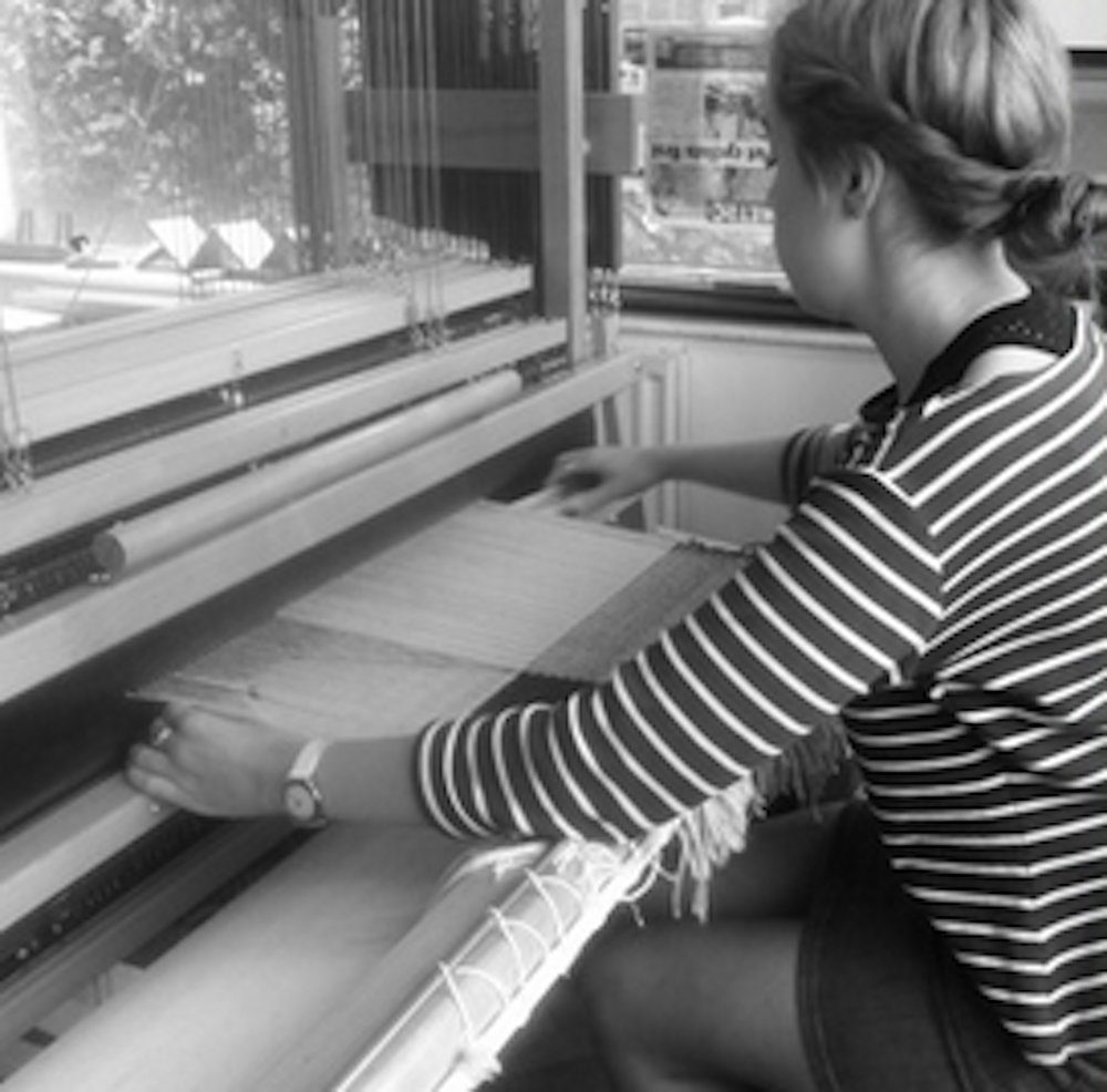 Beatrice samples fabrics and designs at the loom in her London studio