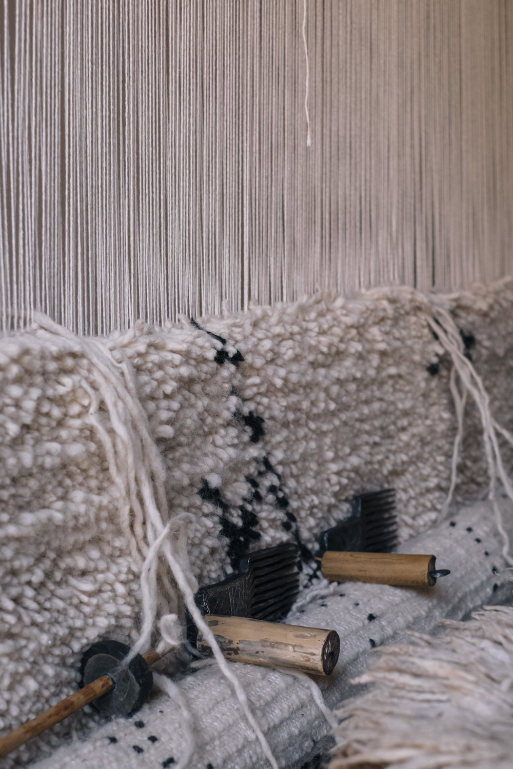 The weaving of traditional Moroccan rugs, with contemporary patterns designed by the artisans, guided by Sabrina Kraus López.