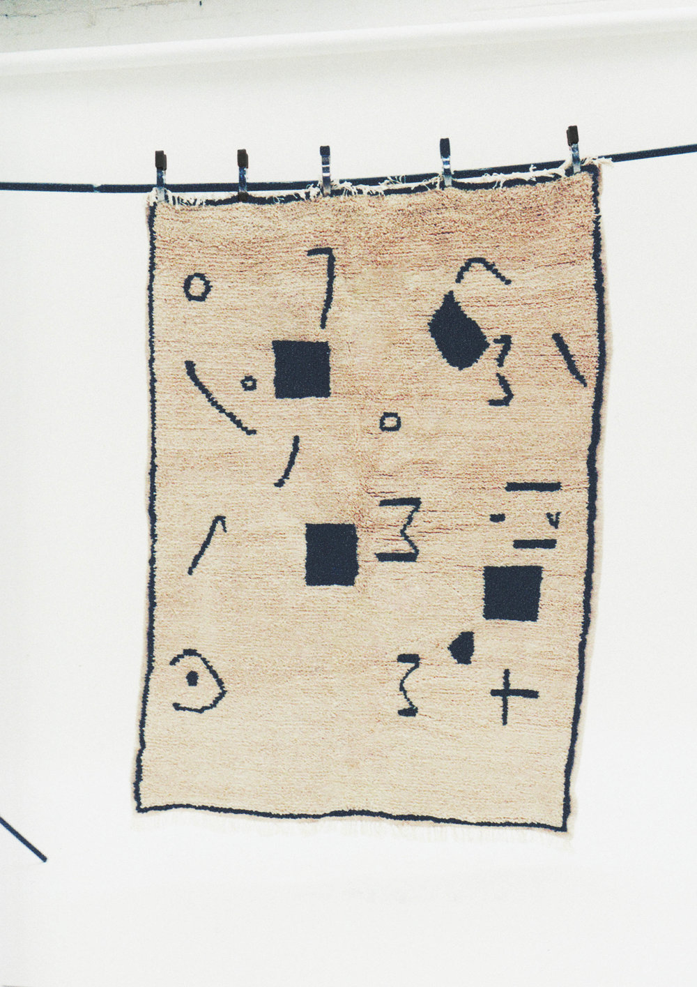 Design exercises conducted by Sabrina, enabled the weavers to create original and contemporary designs, which were transformed into rugs like this one.