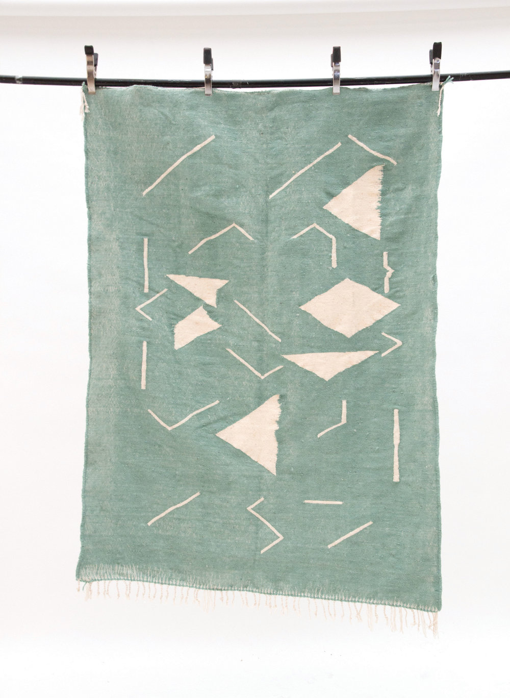 Contemporary rugs created by the Moroccan weavers, during the 'Common Thread' residency