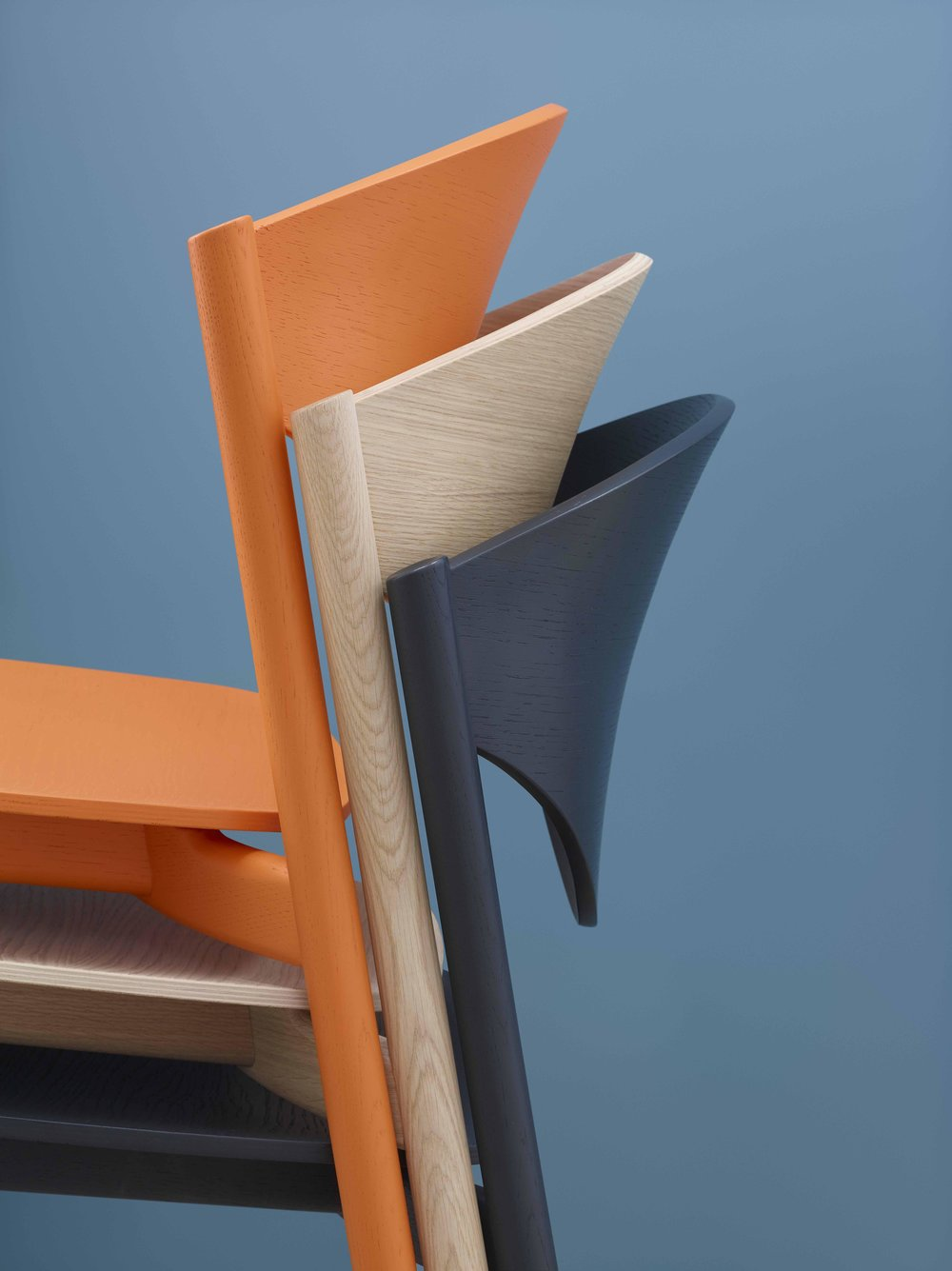 The  March Chair –developed for Modus by SmithMatthias, in collaboration with Sir Kenneth Grange– is a bold, beautiful and stackable chair.