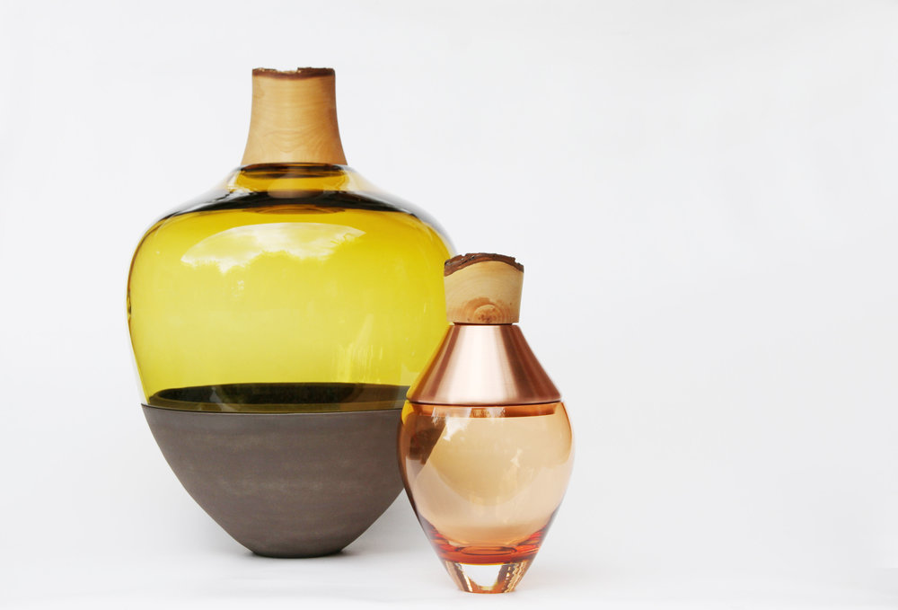 The  Stacking Vessels,  employ unexpected combinations of glass, metal, ceramics, and wood.