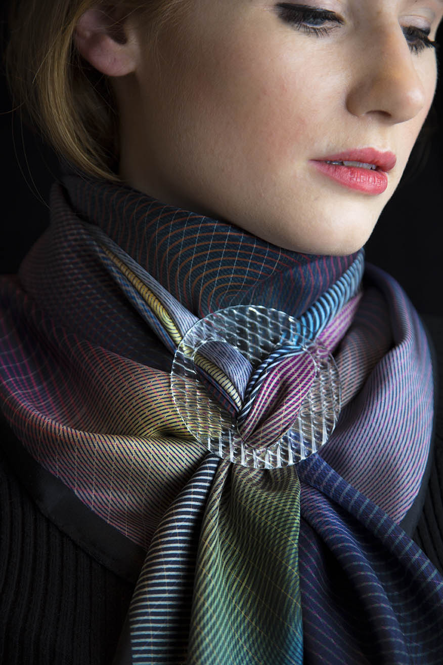 Fine printed silk scarves with graphic patterns , accompanied by  scarf rings made by glassmakers in Istanbul:  Through the Looking Glass , by Rive Roshan, In collaboration with Bilge Nur Saltik