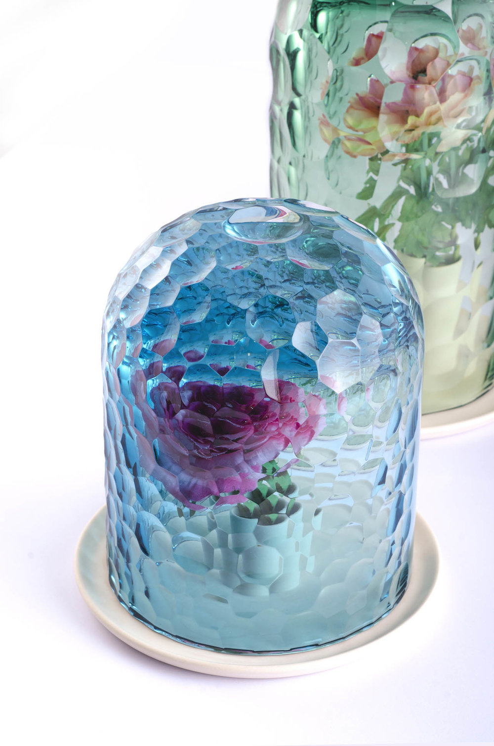 The  OP-Vase  collection  by Bilge Nur Saltik, creates a kaleidoscopic effect with its   unique technique of cutting glass, a timeless material.