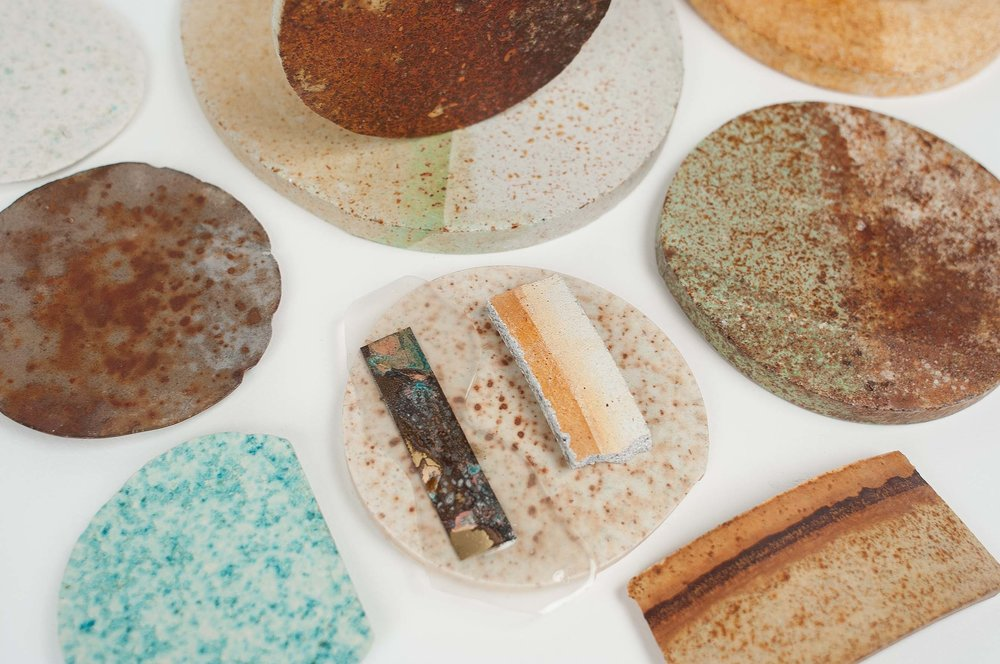 Ariane tested the collected metal dust–a blend of metals such as steel, copper, and brass–and its many variations in an oxidized form for her RUST collection. Seen here,  are samples created during the making of this collection.