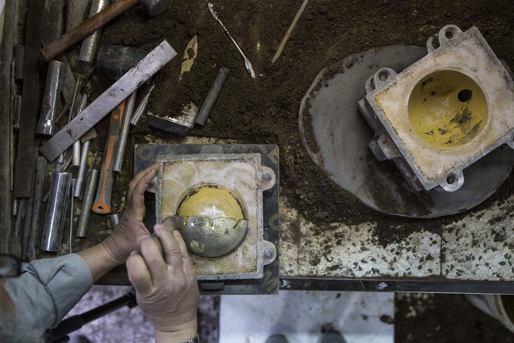 Dual Bowls  by Kawther Al Saffar, being cast by craftsmen at the Alwafi Foundry