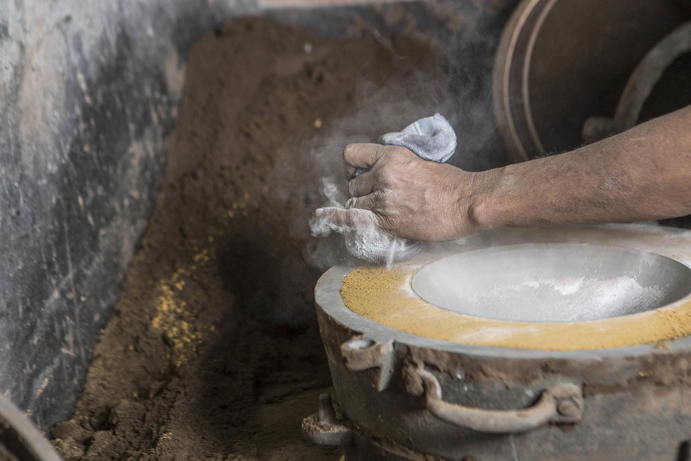 The  Dual Bowls  being cast by a naturally sustainable sand casting method that requires no chemicals