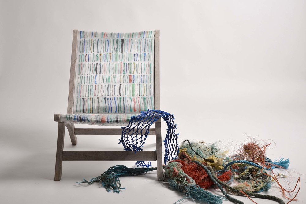 Carmen Machado's textile, seen used as upholstery for a chair here, alongside the  discarded fishing lines and netting.