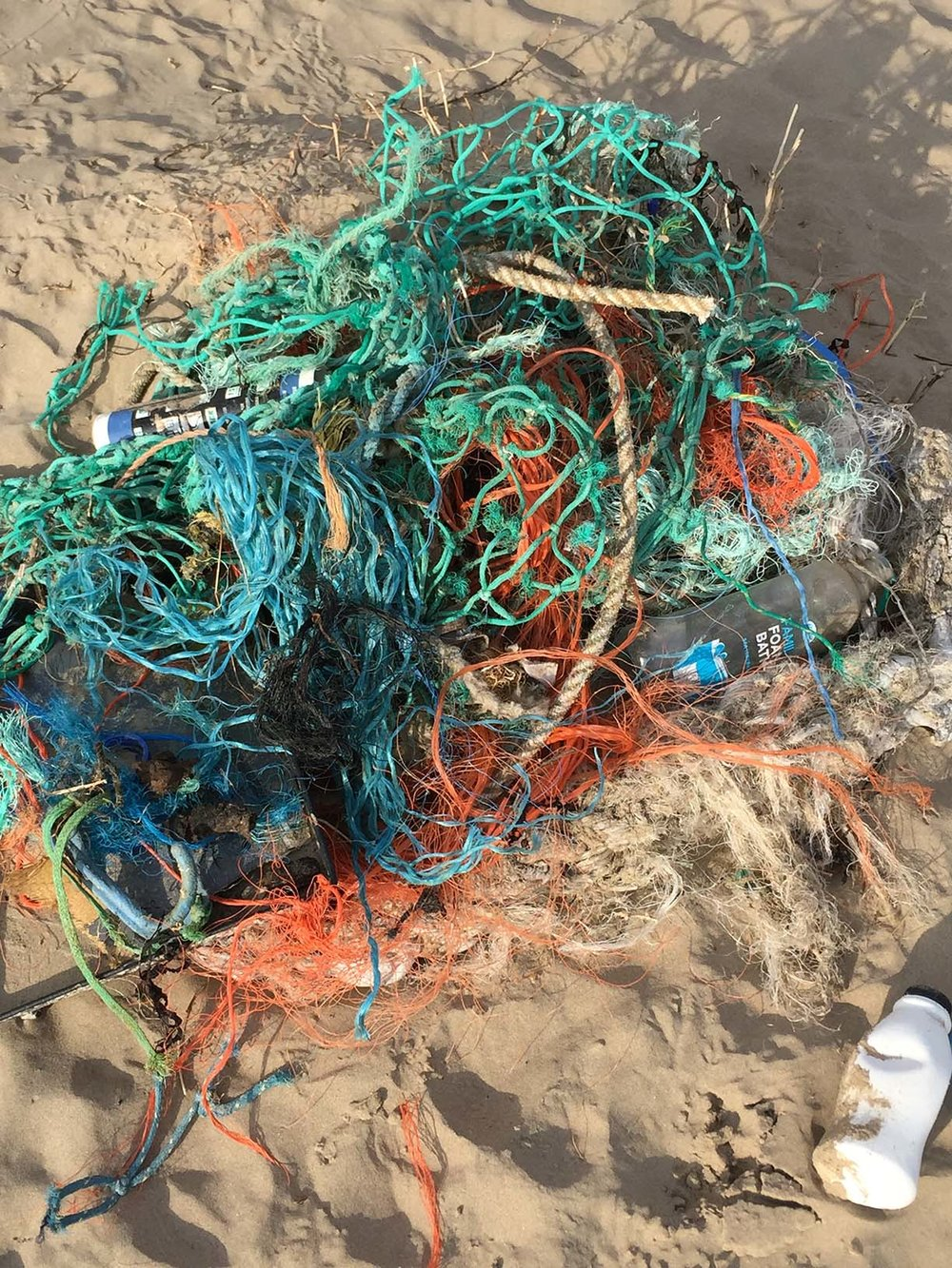Discarded fishing lines and netting collected by Carmen at a beach.