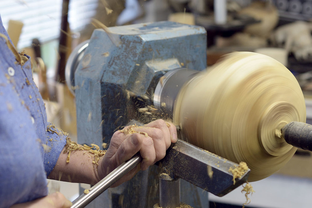 Eleanor turning wood in her studio space. Image courtesy George Selwyn-Brace