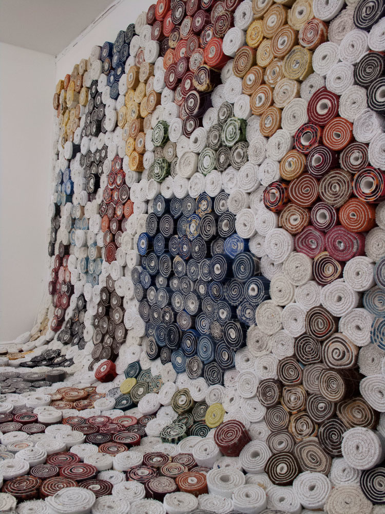Carpet Carpet, by  We Make Carpets  was created from 3500 rolled carpet cutoffs. and was commisoned by  Lynfabrikken , Aarhus, Denmark.