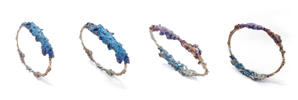 Bangles from Sara Chyan's  Emotional Jewelry  collection; Materiality–Bismuth and 925 Sterling Silver