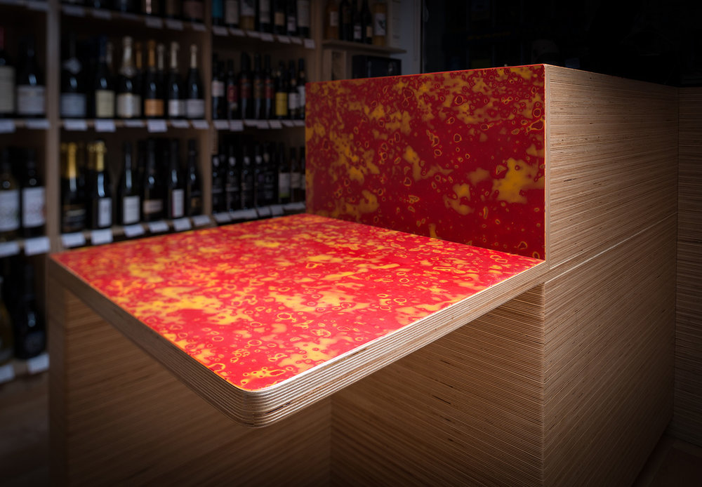 Mirrl's vibrant red and orange colorway applied to a bar top surface