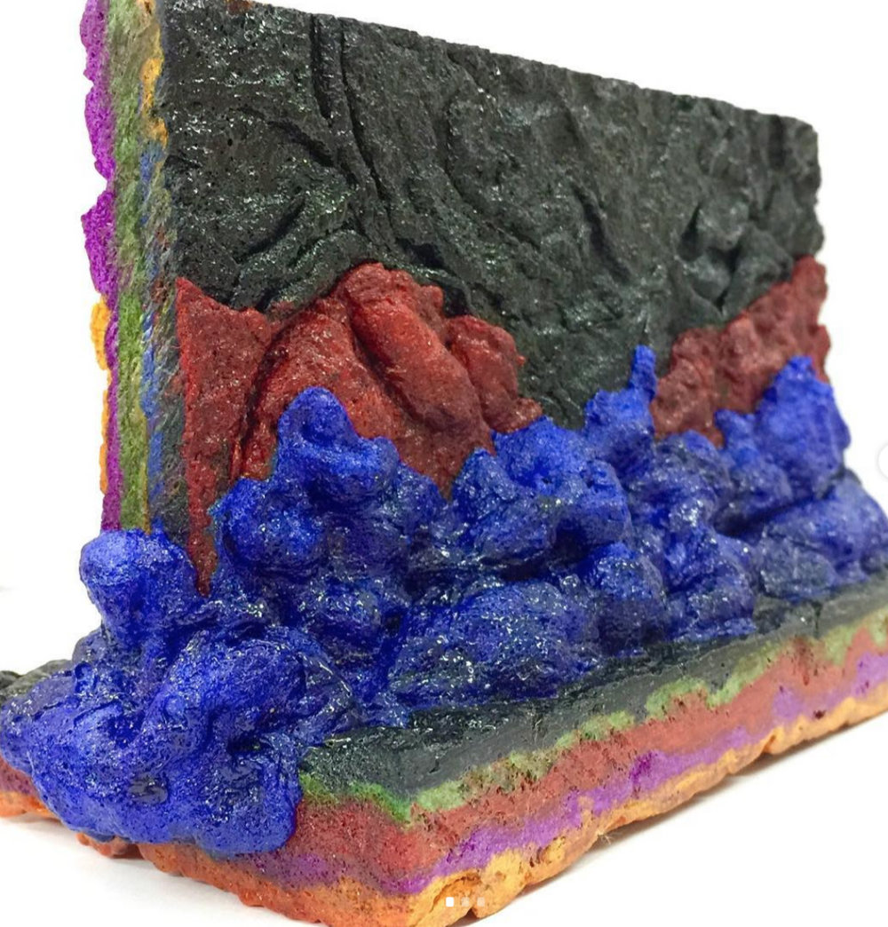 A durable, structural material being developed by Sam Lander by layered the recycled polystyrene