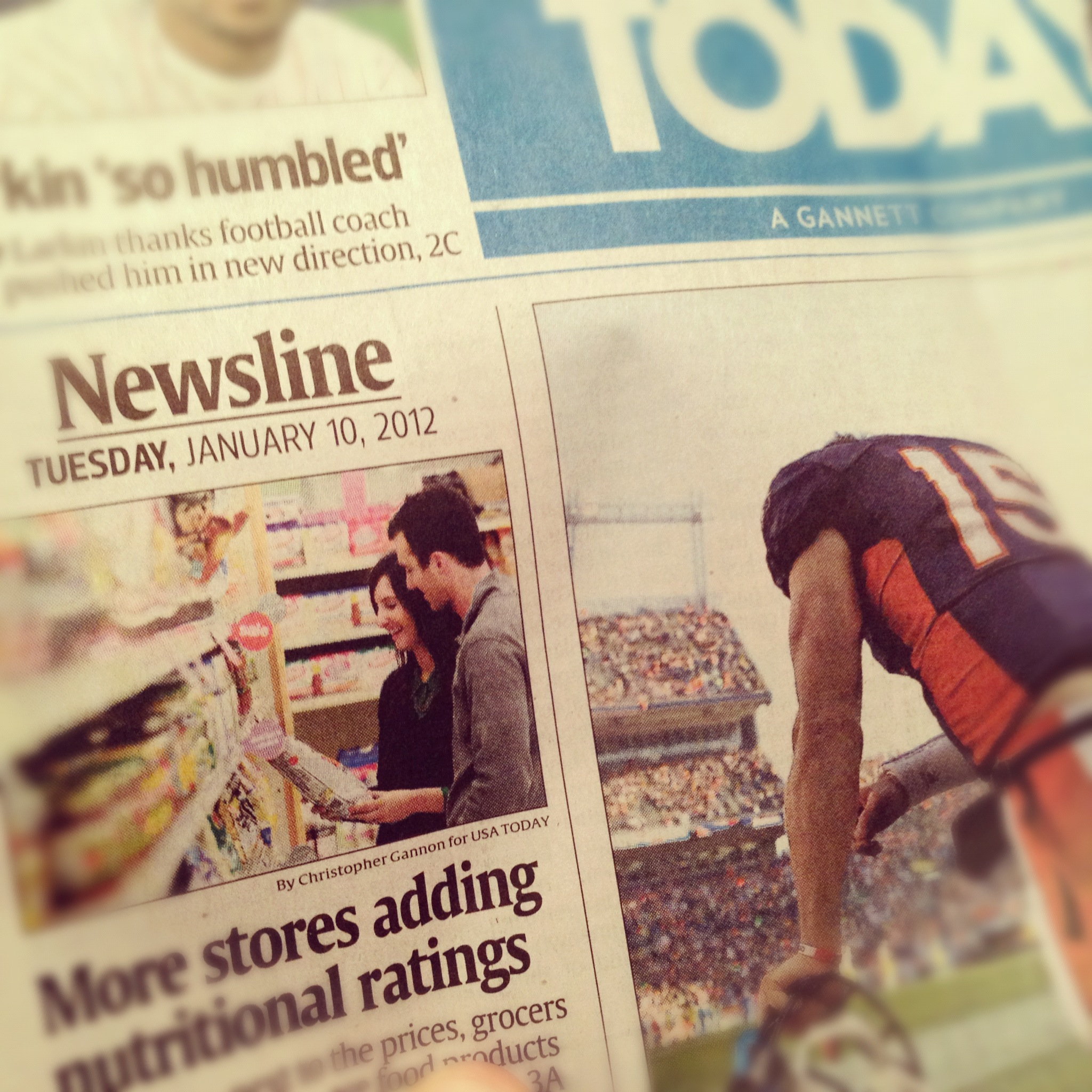 USA Today next to Tim Tebow