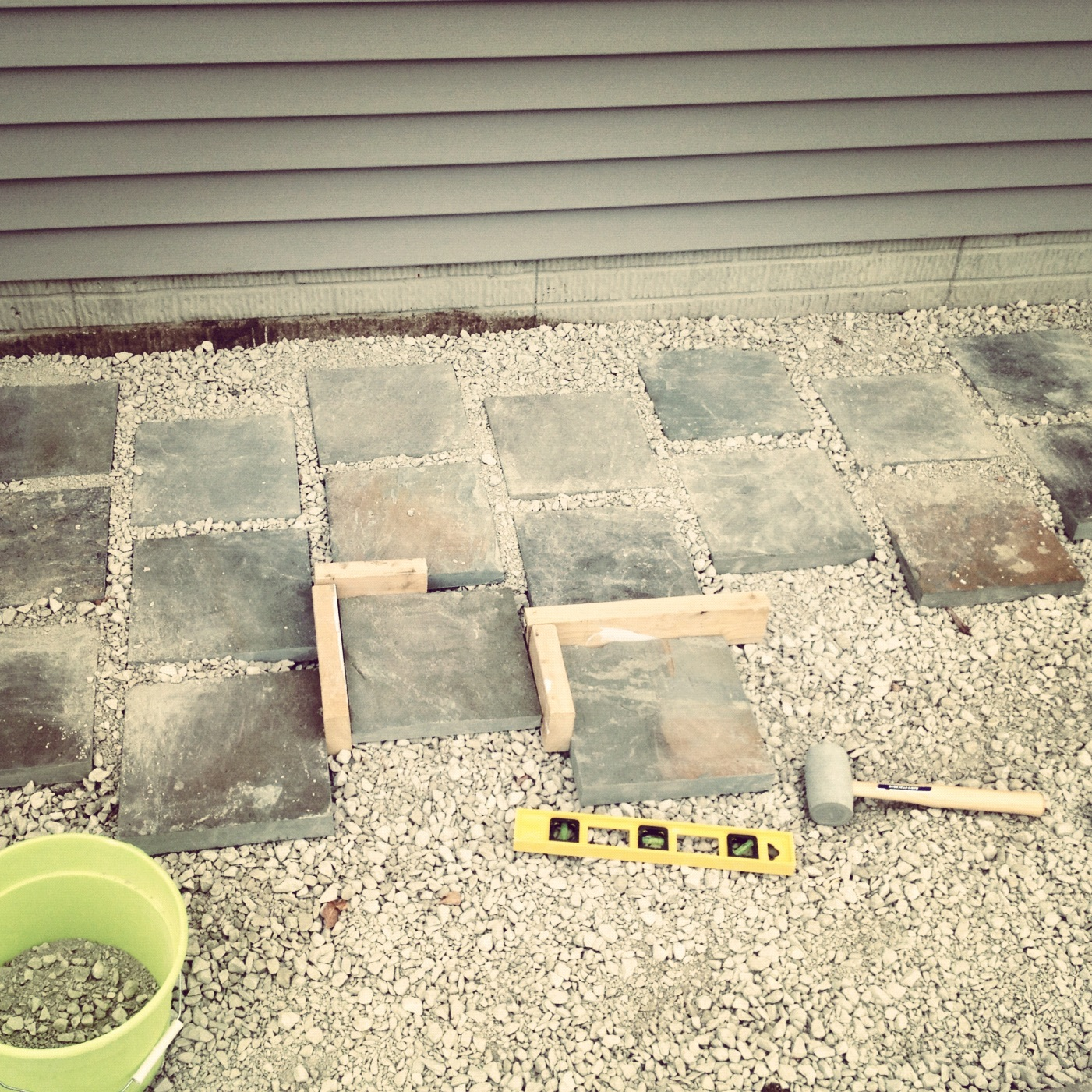 Landscaping laying pavers