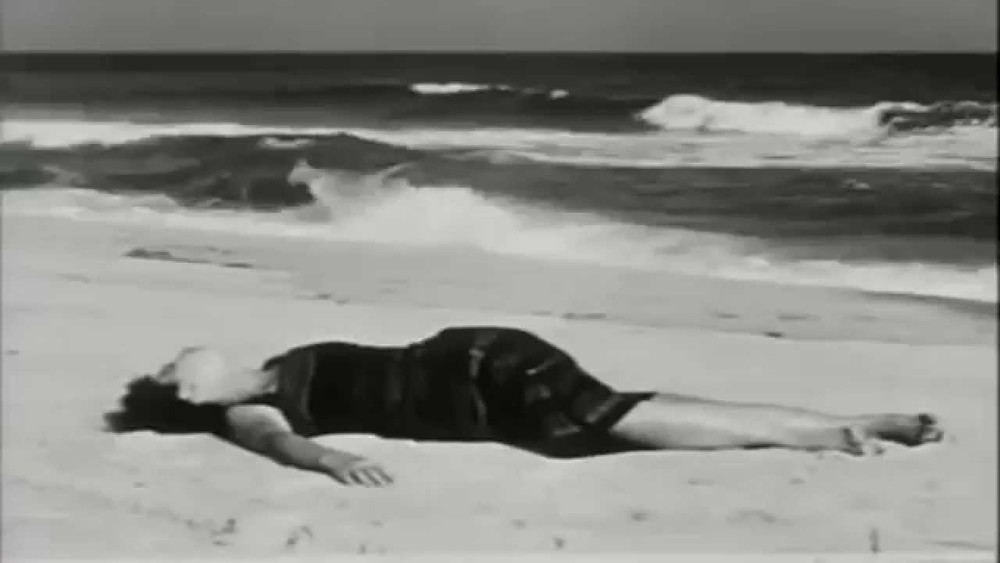 Maya Deren writes, directs, edits, and stars in the short film  At Land
