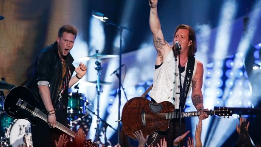 Tyler Hubbard of Florida Georgia Line performing in a Roxenstone custom vest at the American Country Awards
