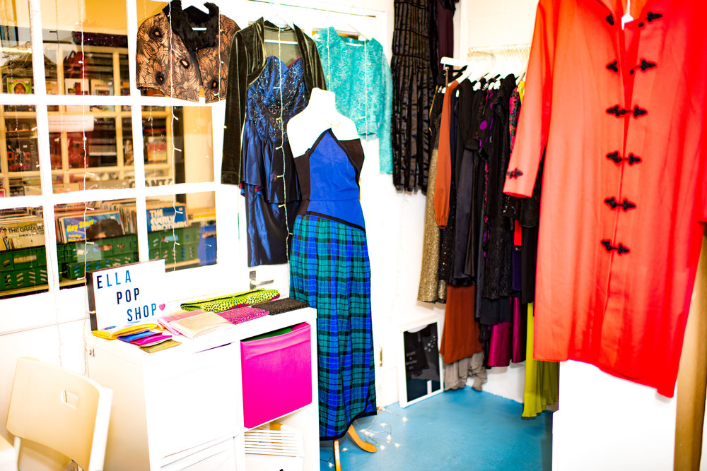 ella pop shop    ella popshop is situated in one of the larger, corner units in the market, and is packed full of vintage ladies fashion from the sixties, stock across europe, and a range of locally produce teeshirts.