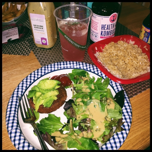 """The company Beyond Meat came up with a plant based substitute for a meat patty. You can make yourself a burger topped with baby spinach, and the """"Sesame Ginger Dressing"""" from Whole Foods.  Photo: Sarah Teskova."""