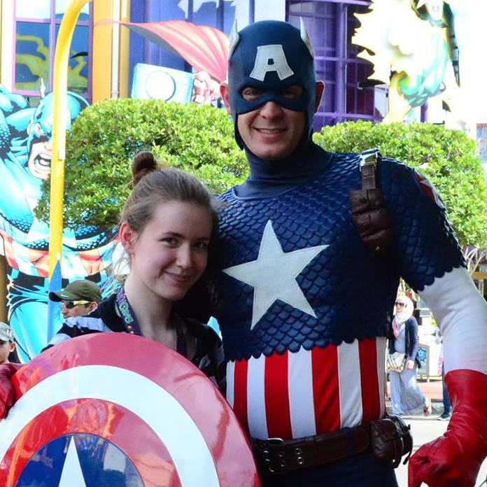 I literally could not find a photo of tiny me dressed up even though I know it exists, so have this picture of me with Captain America instead