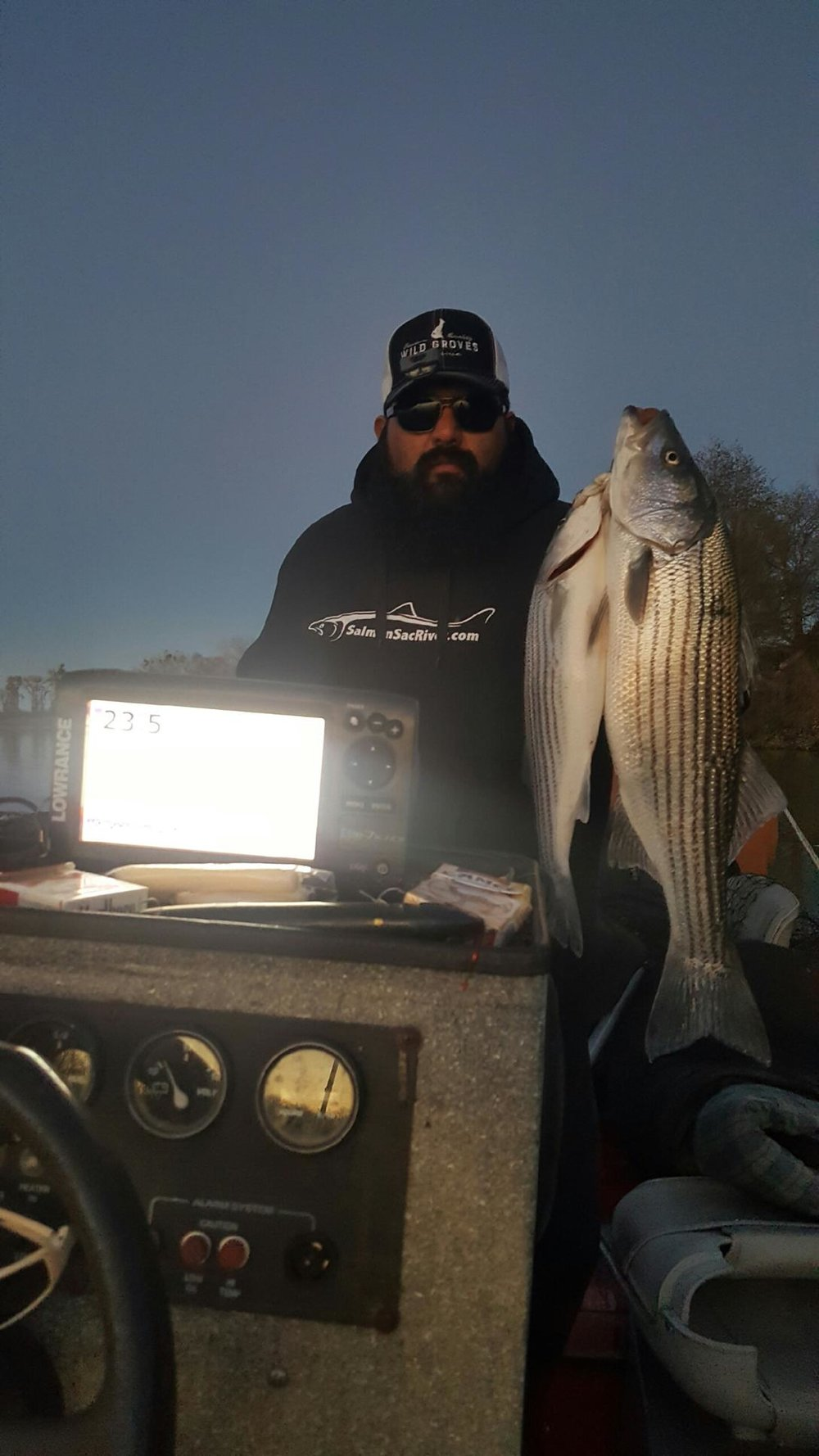 Oscar Nerey, a Northern California olive farmer holds up his limit of striped bass he caught with Sacramento River Striped Bass Fishing Guide Mike Rasmussen of  SalmonSacRiver.com  on December 29, 2016.  Mike's Fishing Guide & Charter Service For Sacramento River Fishing targeting King Salmon, Sockeye Salmon, Striped Bass, Sturgeon, Shad And Trout the best Sacramento River Fishing guide and Sacramento River Charter on Sac River