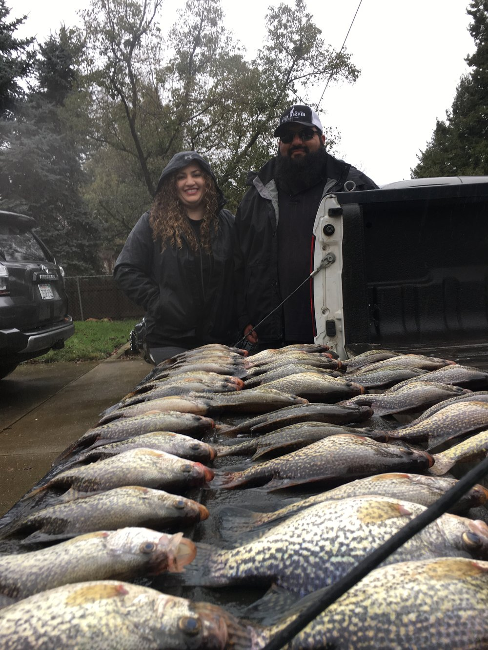 Oscar Nerey and his wife Lauren Nerey show off their catch of Clearlake Crappie on January 6, 2017 while fishing with local fishing guide John Pear (J.P. Guide Service  tel:707-536-3984 ).  Mike's Fishing Guide & Charter Service For Sacramento River Fishing targeting King Salmon, Sockeye Salmon, Striped Bass, Sturgeon, Shad And Trout the best Sacramento River Fishing guide and Sacramento River Charter on Sac River