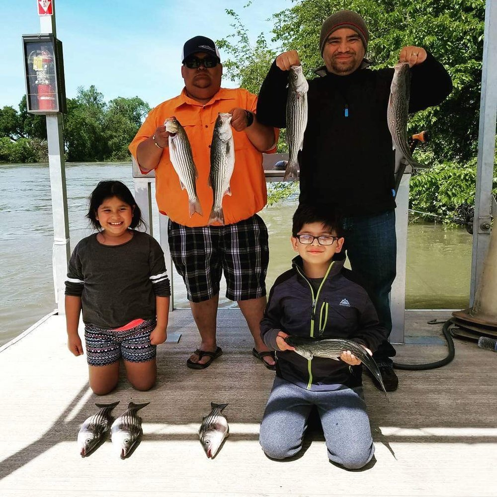 A day spent with the kids on the river can be one of the most rewarding days of fishing you could possibly have.  All smiles here as these youngsters found plenty of action on the Feather River while fishing with Mike Rasmussen of SalmonSacRiver.c0m
