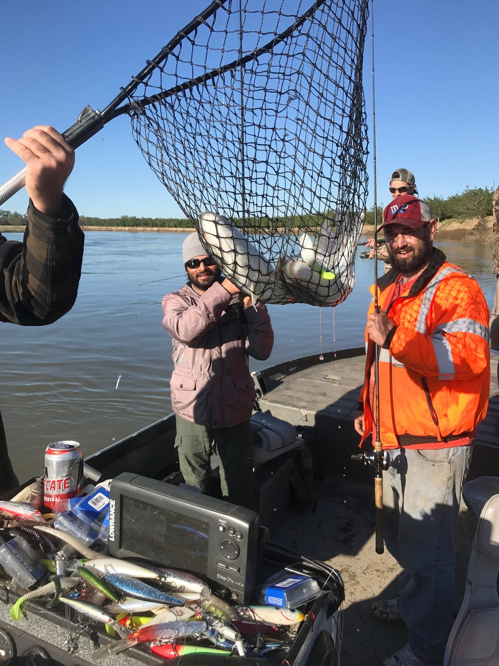 Jeff Guinn and Satinar Chatwell landing a double hook-up on the Sacramento River above Colusa, Ca on April 29, 2017. Bryan Wingrove and son Shawheen Wingrove are pictured in the back ground.