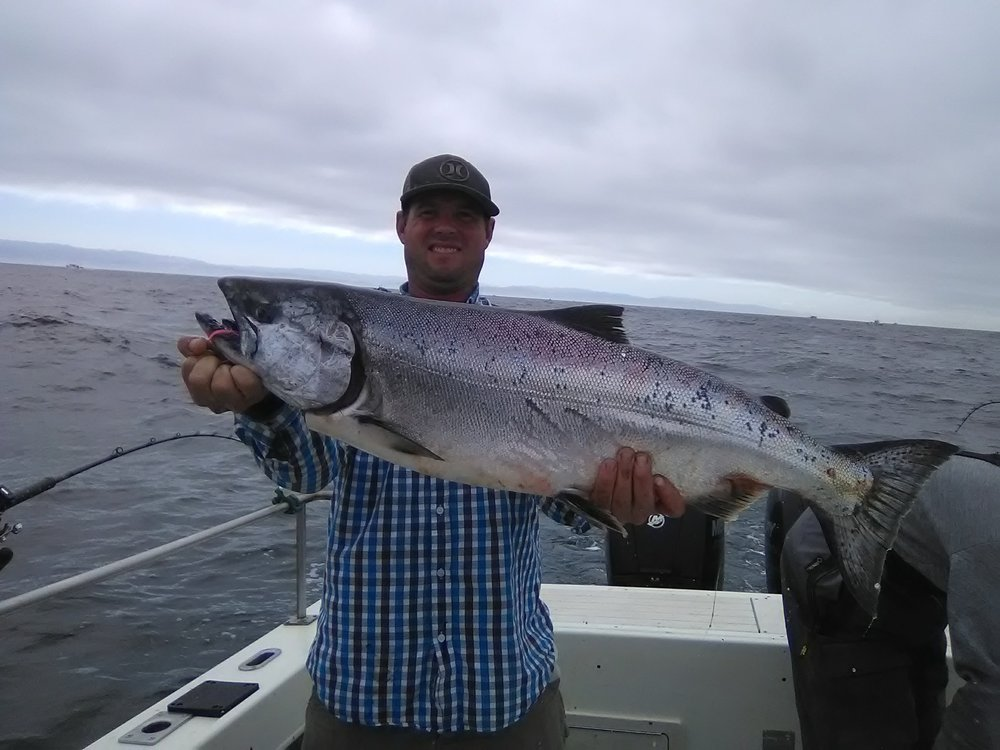 Jason Clack from Corning, Ca hold up a dandy of a fresh Pacific king salmon he caught while out with Legal Limit Sport Fishing on July 26, 2017.
