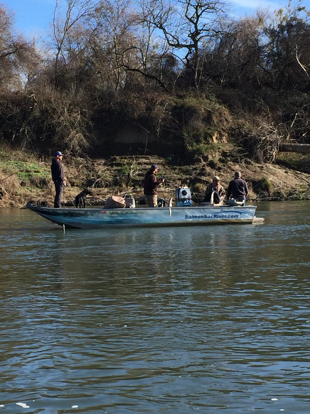 John Patterson, Cole Barnes, and Dakota McFall stand casting for striped bass on the Sacramento River on January 18, 2018, with striped bass fishing guide Mike Rasmussen owner of  SalmonSacRiver.com . Photo courtesy of Billy Driessen of Driessen's Guide Service, who was out fishing for giant striped with clients of his own.