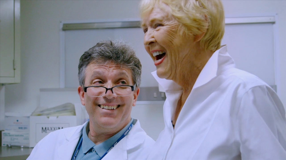 "Director Jean Carper gets the results of her brain Pet scan from Dr. Sam Gandy, Mount Sinai, New York. (Screenshot from ""Monster in the Mind,"" Carper, J. Producer, 2017)"