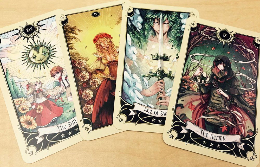 The Sun, 9 of Pentacles, Ace of Swords, and the Hermit.