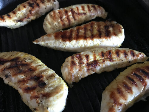 grilled chicken tenders in a cast iron grill pan