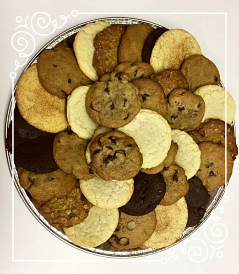 When you really need a lot of cookies... - We offer gorgeous (and of course yummy!) cookie trays that are perfect for your next meeting, party, play, dance performance, recital, study break, symposium, etc. We can also bring over lots of milk to go with all those cookies. Just let us know.Large orders can be delivered any time from 10 am until 12 am. Please give us at least 24 hours to create orders of over 25 cookies.To order or to discuss pricing for large orders, either click here, send us an email here, or give us a call at 603-COO-KIES. If you are ordering for a non-profit organization, please put your tax id number in the comments section and order from the non-profit organization selections. Enjoy!