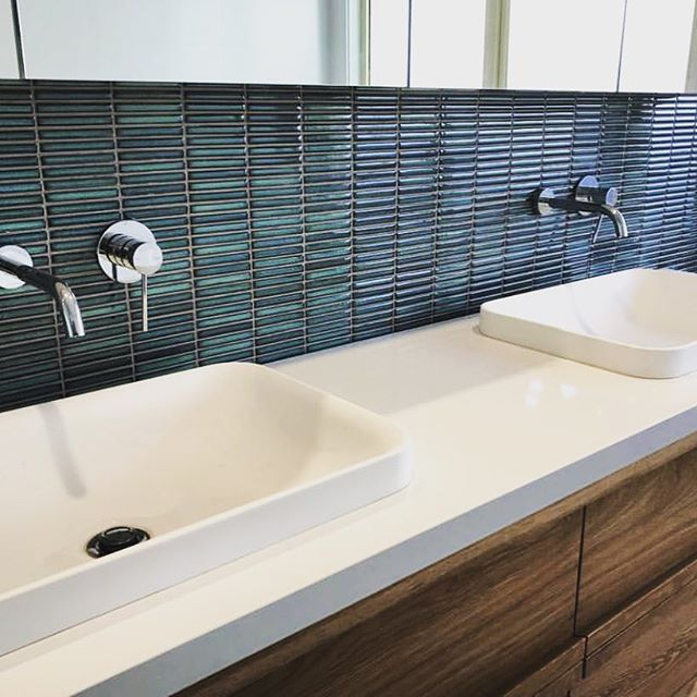 Another beautiful space by @yourbeautifulhome.com.au @baugroupconstruction using our finger mosaics! Such an impact! #mosaics #timber #bathroom